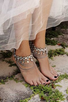 Choose a dress that flows with the breeze. Sole less shoes, and hints of sparkly, boho luxe jewelry completes the look. A beach bohemian bride does what comes naturally.