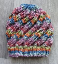 Swirl Hat pattern by Mandie Harrington : This is an easy to knit hat, worked with soft fingering weight yarn that is quick to knit up and stretchy enough for longer wear in growing children. Soft yarn and close fit makes this great for chemo hats. Loom Hats, Loom Knit Hat, Loom Knitting, Knitting Stitches, Knitting Patterns Free, Free Knitting, Knit Crochet, Knit Hat Patterns, Knit Hat Pattern Easy