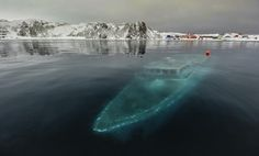 33 Most Beautiful Abandoned Places In The World: Sunken yacht in Antarctica