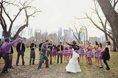 Bride vs. Groom at hula hoops! Photo by Red Bird Hills photography