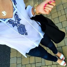 IG @mrscasual <click through to shop this look> embroidered top. Jcrew toothpick skinny jeans. White wedge espadrilles. Black tote bag. Monogram necklace.