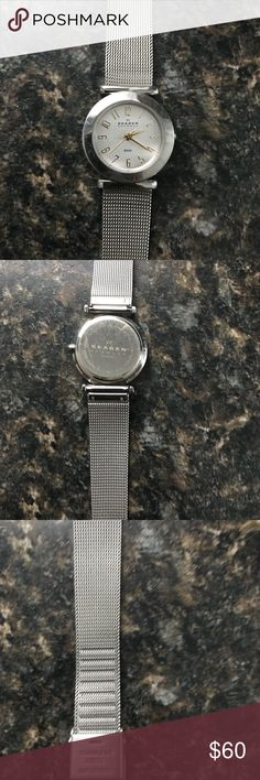 Skagen silver and gold watch Skagen silver and gold watch. Tiny little Mark on band as shown and a few little scuffs but nothing serious. Skagen Accessories Watches