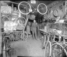 Great old bike shop ... Makes me want to step into the photo & start browsing around...