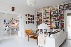 Scandinavian Home and atelier of Donald Arhøj - White Sofa, White Bookcases, Same Ikea Stockholm Coffee Table