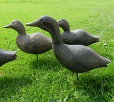 """A fine set of vintage duck decoys by Maurice """"Bunt"""" Dowd, of Union Springs (Cayuga Lake), New York. The set have good age and look like they date circa 1930's or so. The bodies are a single piece of wood with attached heads and glass eyes, they are all original."""