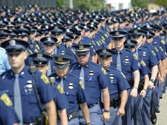 MSP Troopers march into the gym, one line at a time.