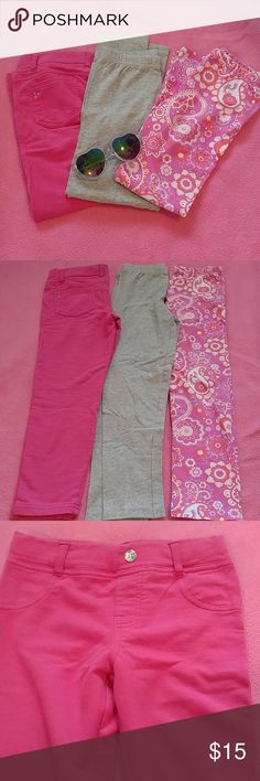 3 pairs of leggings Three pairs of leggings, one is magenta with a crystal button and faux pockets on front with real back pockets with rhinestone detail. They are by Extremely Me! and have adjustable straps around the waist on the inside. They are size 6. The second pair are sparkly grey from Carters. They are size 6x. The third is a magenta, pink and coral paisley pattern that have never been worn. They are a size 6x and are by Kids Korner Various Bottoms Leggings