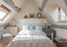 This charming country bedroom is in the attic gable and the reproduction bed is from The Original Iron Bed Company, while the bedding including the cushions is from Cologne and Cotton. Walls and ceilings are finished in Muslin by the Little Greene Paint Co. The beams have been painted in Tarletan eggshell, then a wash of diluted white emulsion paint has been dragged over the surface then wiped off to give a lime-washed effect. The reproduction antique oak doors throughout are from…