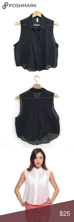 """American Apparel Sleeveless Lawn Crop Button-Up SUPER CUTE American Apparel Sleeveless Lawn Crop Button-Up in Black. Size Medium / Large. Excellent Used Condition. No visible flaws. 3rd photo is the same style, different color--included to show fit. Semi-sheer fabric! Peter pan collar. Cropped fit. 100% Cotton. Machine wash cold. Tumble dry low. Chest: 22"""". Shoulder: 13"""". Length: 18.5"""". American Apparel Tops Crop Tops"""