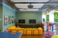 St Petersburg Offices - Mail Games: BRIZ Studio developed these new St Petersburg offices for the online games company Mail.Ru Games. The two floors of the headquarters are brightly decorated, with greenery complementing the fun features, including games facilities and vibrant furniture.