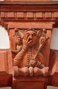 """Fool """"looks through his fingers"""" [idiom meaning secretly to condone] late 16thC terracotta figure on the 2nd storey of the courtyard of the Schallaburg near Melk, Austria. Photo via www.sagen.at"""