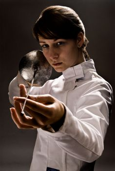 Female fencer holding fencing foil - photographer: Buero Monaco.  For more information on the different types of  fencing weapons visit this page http://academyoffencingmasters.com/blog/fencing-rules-for-novice-parents-differences-for-foil-epee-and-sabre/ . This is a fencing foil, both according to the photographer and the referenced site.