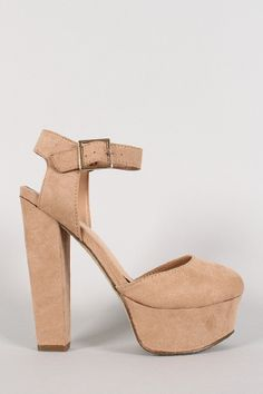 """Breckelle Suede Round Toe Ankle Strap Platform Pump. Description Featuring smooth faux suede upper, round toe, wrapped platform, thick heel, lightly padded insole, and adjustable ankle strap with buckle closure.Material: Faux Suede (man-made)Sole: Synthetic  Measurement Heel Height: 5.75"""" w/ 1.5"""" Platform (approx)Fitting Tips:Foot Model is a true size 6, foot measures 8.9"""" from heel to toe, width measures 3.25"""".Model's Review: True to size."""