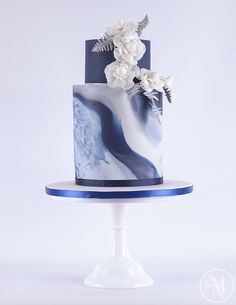 Icy Blue Marble Cake with Chanel inspired camellias by The Enchanting Merchant Company - http://cakesdecor.com/cakes/225625-icy-blue-marble-cake-with-chanel-inspired-camellias