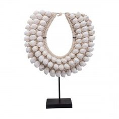 With three graduated rows of white cowrie shells woven in with rope knotting, this ornamental necklace display piece is sure to provide a stunning addition to your home. Shell Display, Necklace Display, Shell Necklaces, Rustic Interiors, Shells, Contemporary, Ornaments, Mirror, African