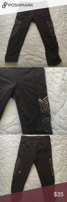 Lululemon leggings Black with reflective tribal print knee length minor pulls on front stitching only noticeable up close. These have deep pockets that run into the thighs lululemon athletica Pants Leggings