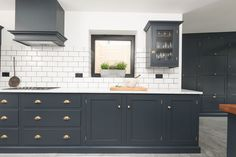 A beautiful Shaker cooker run painted in Pantry Blue with Bella Brass Handles and gorgeous tiled splashback