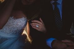 This is the perfect shot to show off your wedding dress, ring, and dapper groom all in one frame!