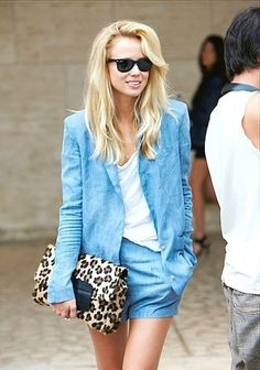 Elin Kling keeps it casual and chic with a white T, a slouchy blazer and chambray shorts.
