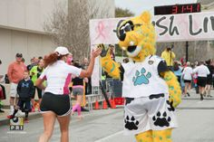 Jaxson de Ville high fiving and cheering on the runners at the Donna 5K