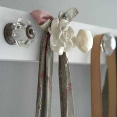 A use for the knobs off the cabinet doors that I'm up cycling...