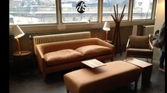 Dare Studios stand at Design Junction. Love this sofa and chair in tan leather!