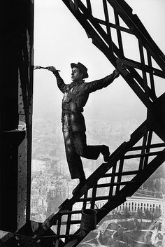 everyone thinks of the painter, but i'm thinking of the photographer :) what fun!    Zazou, le peintre de la Tour Eiffel, Paris, France, 1953 by Marc Riboud