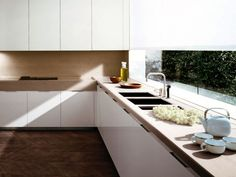 nice cabinet pulls and herringbone floor pattern// varenna