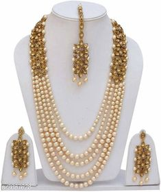 Jewellery Set Elegant Pearl Jewellery Set Material: Pearl Size: Free Size Description: It has 1 Piece of Necklace 1 Pair of Earrings & 1 Piece of MaangTikka Work: Stone & Beads Work Country of Origin: India Sizes Available: Free Size   Catalog Rating: ★4.3 (443)  Catalog Name: Feminine Elegant Pearl Jewellery Sets Vol 1 CatalogID_276459 C77-SC1093 Code: 433-2087628-918