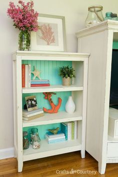 white bookcase with a painted blue-green back