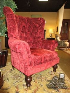 """Lillian August tufted wingback chair in a cranberry colored upholstery on casters. What a grand chair for your living room or office! Perfect traditional style piece. 40""""wide x 37""""deep x 50""""high."""