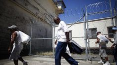 Inmates leave the exercise yard at San Quentin state prison in San Quentin, California. (REUTERS/Lucy Nicholson)