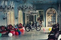 """<div class=""""artist""""><strong>Tim Walker</strong></div><div class=""""title_and_year""""><em>Motorbike in Ballroom, Goa, India, 1999</em></div><div class=""""medium"""">C-type print</div><div class=""""dimensions"""">60.4 x 82.6 cm</div><div class=""""edition_details"""">Edition of 15</div><div class=""""signed_and_dated"""">Accompanied by a signed, titled and editioned label from the artist</div>"""