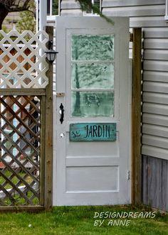 Old door repurposed as garden gate