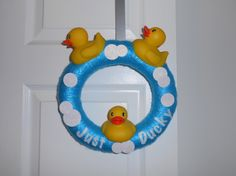 """Just Ducky wreath. A small 10 inch wreath for a bathroom. I wrapped the straw wreath in shiny blue yarn added sparkly white circle for bubbles and cut 3 rubber duckies in half and glued and pinned them in place and I cut out the """"just ducky"""" letters in glitter felt."""