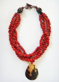 Irma Guzman Eco Jewelry - Granada, acai seed necklace with shell pendant.