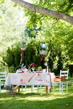 outdoors party decor - I like the hanging baskets.