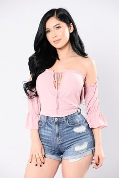 - Available In Rose - Off The Shoulder - Cropped Top - Mid Sleeve Length - Neckline Tie Detail - Ruffle Detail - Made in USA - 96% Polyester 4% Spandex