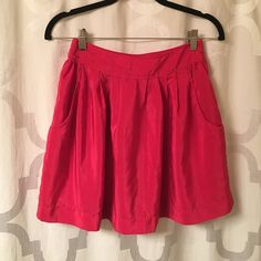 Hot Pink Skirt WITH POCKETS!!! Hot pink skirt with pockets. Perfect layered with sweaters, tanks and button down shirts. Size small. 100% Polyester Other
