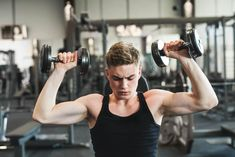 Young fit man in gym exercising with dumbbells. photo by halfpoint on Envato Elements Hispanic Men, Young Fathers, Lift Heavy, Barbell, Mens Fitness, Gym Workouts, Abs, Exercise, Stock Photos