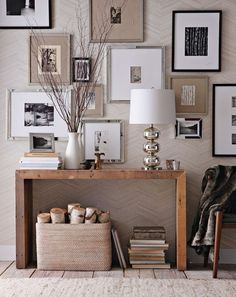 Love the mix of burlap, white, black and silver frames.