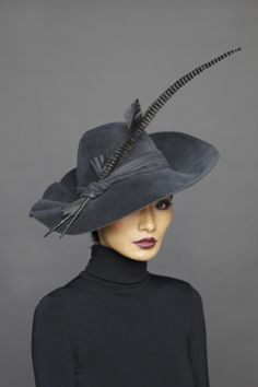 feathered hat....I'm not into hats, but this one is so pretty and elegant!