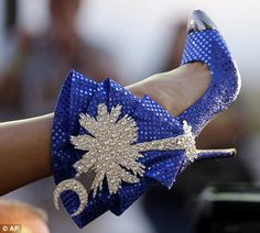 Miss South Carolina Brooke Mosteller displays her shoe during the Miss America Shoe Parade at the Atlantic City boardwalk, Saturday, Sept. 1...