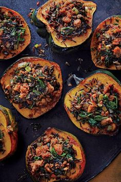 This two-for-one dish of wild rice stuffing and roasted acorn squash is a sure crowd-pleaser. You can cut the stuffed halves into quarters so they don't take up as much room on the plate.#thanksgiving #thankgivingrecipes #thanksgivingturkey #thanksgivingmains #turkeyrecipes
