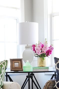 A new lamp, like this one from HomeGoods, is a quick way to update and modernize a room. I added a ceramic lamp here for some interesting contrast with the mirrored table and other wood and metallic accents. Sponsored post.