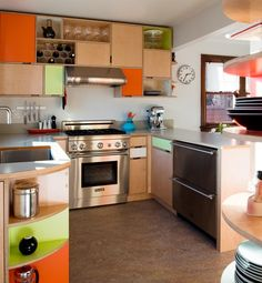 Intermittent bursts of color pop on wood cabinetry. In these kitchen cabinets by Kerf Designs, colored plastic laminate lines various places of the plywood.