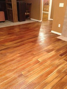 """Stained concrete """"wood"""" floors would look fabulous in my basement."""