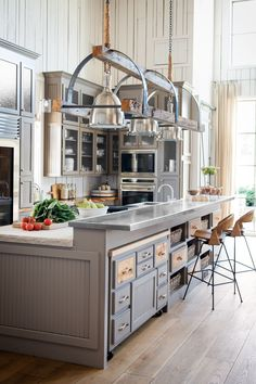 Hardworking Kitchen Island The light fixture is interesting I like the two level island that is long and narrow.