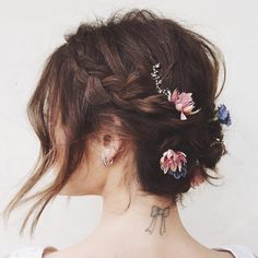 Lucy Hale - Lucy Hale gave us herspinonflower crowns with this Pinterest-worthy look. She added actual blooms to her crown braid, and made sure to leave a few strands out for a romantictouch.