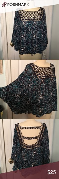 XL top from Aeropostale This top from Aeropostale is a size XL. Has a lace yoke at front and lace at back. Has a batwing sleeve. New with tags. Print is white, navy, and turq. Aeropostale Tops Blouses